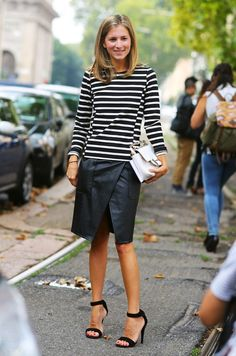 Stripes, leather skirt, chic ankle strap heels, and a white bag.