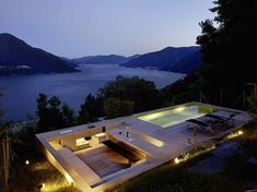 Concrete house in Brissago, Switzerland by Wespi de Meuron Romeo Architects - a pool terrace with sunken bar