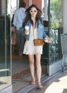 Shady lady! Jessica Gomes cuts a chic figure in summer frock and white sunglasses as she heads out for lunch in Hollywood on Wednesday... after baring all in THOSE sex scenes with Bruce Willis