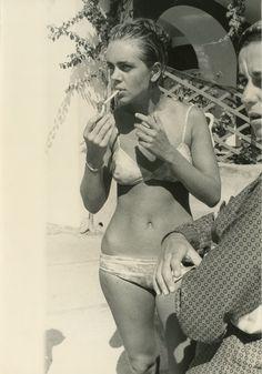 Actress Barbara Ruffo lights a cigarette in Capri, Italy, 1960s.