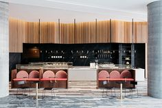 Inserted into the ground floor of the new Commonwealth Bank office building, Studio Tate has designed this cafe around the historic idea of a treasury.