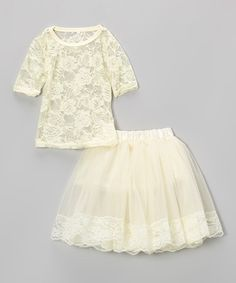 With a sheer lace top and delicate overlay skirt, this set invites cuties to indulge in girly, twirl-worthy fashions. The floral trim and stretchy satin waistband make the skirt the perfect pick for any ensemble in need of a little poufiness.Includes top and skirtTop: 100% polyesterSkirt: 100% nylon chiffon