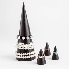 Black wooden bracelet display that is a cone shape. Attention grabbing and attractive, this black cone is ideal for bracelets in a jewellery shop. Wood Bracelet, Bracelet Watch, Jewellery Displays, Earring Hole, Bracelet Display, Black Jewelry, Bangles, Bracelets, Fashion Boutique