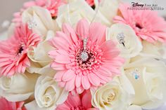 Pink gerber daisies and white roses with Hidden Mickey bling