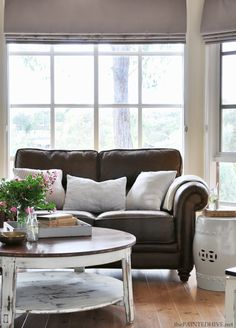 Still loving this look after all these years - brown leather, white and blue or black ticking, and lots of neutrals. This blogger, The Painted Hive, also has some great closet door re-dos