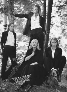 "Kate Moss Turns 40 - The cummerbund has never looked so chic. With Lucie de la Falaise, Stella McCartney, and Marianne Faithfull in November 1997's ""High Camp,"" photographed by Bruce Weber, styled by Giovanna Battaglia."