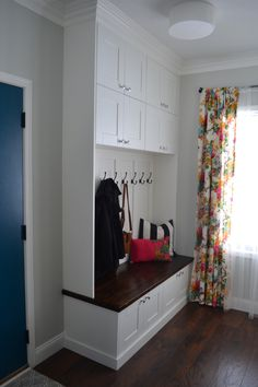 Love these DIY built-ins. The top cabinets are super smart for hidden storage