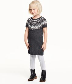 Jacquard-knit dress in a soft cotton blend with alpaca wool content and glittery threads. Short raglan sleeves. Unlined.