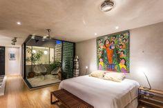 Stunning modern bedroom with outdoor inspired area. Recámara Principal, by: Taller Estilo Arquitectura.