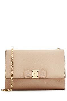 We love the simplicity of Salvatore Ferragamo's ultra-sleek 'Ginny' shoulder bag. Coated in textured beige leather, the brand's signature grosgrain bow is the only accent #Stylebop