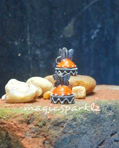 Quilled orange jhumka http://magicsparklz.blogspot.in/2015/05/quilld-orange-jhumka-with-butterfly.html