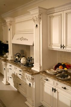 exactly how my cabinets will be around my stove and venthood cabinet.. also love the dark hardware on the antique white cabinets... just LOVE this kitchen.