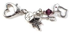 """Perfect gift for your favorite RN ~ Nurse whom will be overjoyed with this gorgeous key chain, purse charm or ID holder charm. Each dangle is handmade & customized with the wonderful Nurses Initial, Swarovski Birthstone Crystal, RN Caduceus charm, stethoscope charm and an adorable heart with nurses hat charm. This handmade dangle is approximately 2.5"""" from end to end."""