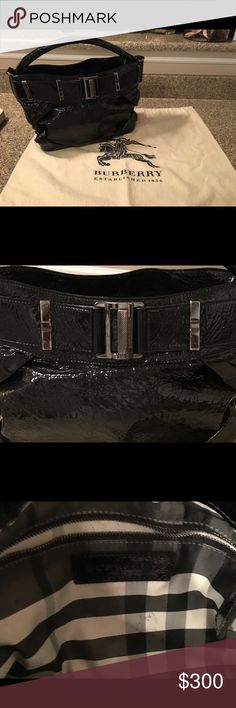 Burberry Purse - black patented Black patented with detailed sides and silver accent pieces.  Classic Burberry lining and magnetic snap closure. Comes with original Burberry keeping bag. Burberry Bags Shoulder Bags