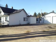 Dream collector or hobby garage! 2 stall double deep (36 x 40) with heat, water, electrcal, drain, storage, plus 2 addti; storage sheds, class 5 for extra parking (semi cab) affordable and updated home new roof, furnace, central air, NEW SEPTIC!