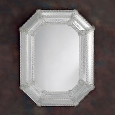 "Octagonal Venetian mirror with hand-etched glass, trimmed with  glass ribbons and rosettes; 26½"" x 34½"" h. Made in Murano, Italy."
