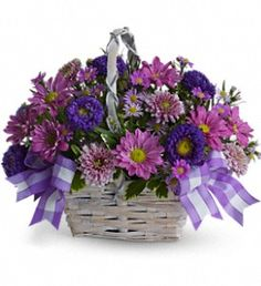 Surprise that special someone today with this Daisy daydream arrangement.  This is a unique twist to flowers with the charming white bamboo basket accented with lavender ribbon.  So don't wait and bring the gift of country spring to someone today!  Call to order at 877-304-1122 or visit us today at http://www.allflowersandgifts.com/.