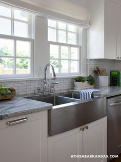 stainless steel deep farmhouse sink + mini white subway tile with light grey grout...yes, please!