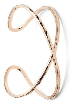 Rose gold accessories, like this shiny cuff bracelet, are always a great way to polish off a look.