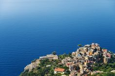 Overlooking town of Corniglia perched on a rocky promontory on Cinque Terre.