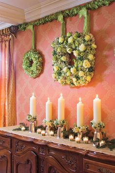 Go Ahead, Be Indecisive! - 54 Festive Christmas Wreaths - Southernliving. These lovely floral wreaths hang from a piece of conduit covered with ribbon. Leave the conduit up for the rest of the year for an easy to rearrange display of artwork. This is a great solution for wallpapered rooms where it would be difficult to patch nail holes.