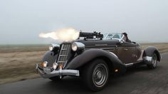 A black Auburn Speedster with twin Vickers guns ...