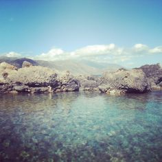 Clear blue sea and mountain views in Crete