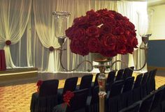 Detail shot of one of the red rose aisle candelabras in this gold, black, white and red wedding ceremony.
