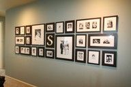 Frames down the hallway. Love this idea.  Maybe one day i will have a long hallway!