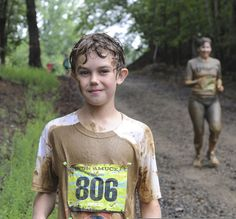 File:A young participant of the Annual Run-a-Muck watches other runners finish the 3.5 mile race at Marine Corps Base Quantico, Va., June 8,...