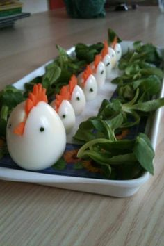 Food creativity/art - Hard Boiled (Chicken) Eggs See the website for directions. Hard-boiled Chicken Eggs - Slice a carrot comb and beak - Add black peppercorns to each side of the egg for eyes eggs - francesco mugnai brings the goods again: fun food trea Boiled Chicken, Chicken Eggs, Cute Food, Good Food, Yummy Food, Awesome Food, Easter Recipes, Holiday Recipes, Easter Ideas