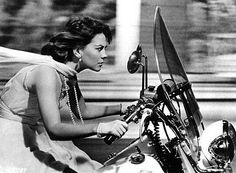 Natalie Wood riding with pearls