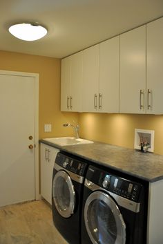 Although I don't like these cabinets & pulls... I like the idea of lights mounted under the upper cabinets.