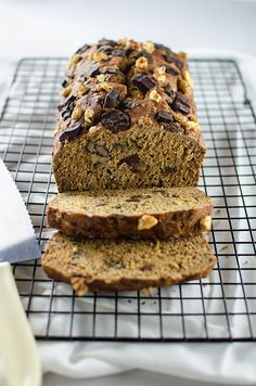 Ultimate Banana Bread - Each bite is filled with bananay goodness and chunks of dark chocolate and walnuts. It's OIL-FREE and healthy enough to eat for breakfast or dessert! (Vegan) | RECIPE at http://NomingthruLife.com