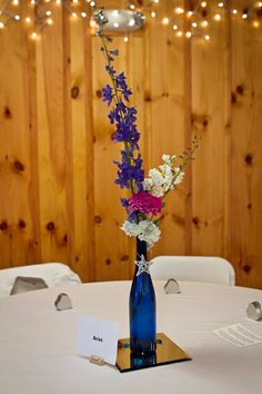 All Rights Reserved, Zumbro Photography.  Centerpieces used at our wedding:  Wine corks used as place card holders and Blue wine bottles for vases