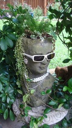 """""""Gracie"""" the Garden Goddess. She watches over my garden looking quite spiffy in her summer attire and greets all my garden guests. She is a little head strong and didn't like her latest """"do"""" 'cuz it was cut too short, but she knows all about the Miracle. The morning sun bothers her, but she has several pairs of cool shades to help ease the brightness."""