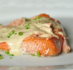 Baked salmon with browned butter sauce 2 lb salmon filet with skin on course sea salt 2 tablespoons butter 1 tablespoon flour 1 cup heavy cream ½ cup white wine kosher salt freshly ground black pepper chives for serving Salmon Recipes, Fish Recipes, Seafood Recipes, Great Recipes, Cooking Recipes, Favorite Recipes, Healthy Recipes, Sauce Recipes, Cooking Tips