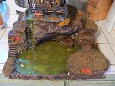 "This piece was made for the Dead Creek Mill and the pick up truck delivery accessory which fits on the little ""island"" in the right corner. It turned out great. Thanks Michael! Halloween Village Display, Halloween Town, Holidays Halloween, Halloween Decorations, Village Miniature, Miniature Crafts, Christmas Crib Ideas, Haunted Dollhouse, Halloween Miniatures"