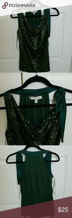 Green and shine Jennifer Lopez blouse size S This is a beautiful  and comfortable  blouse never used but was washed and no longer have the tag. Jennifer Lopez Tops Blouses