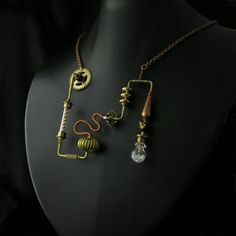 Crystal Steam Pendant This is a very theatrical mad scientist steampunk costume piece. I wanted it to look like the brass tubing (surrounded by a