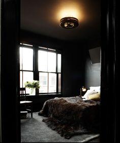 Roman and Williams - Ace hotel NYC - dark bedroom - black walls - fur