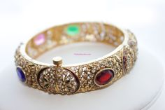 Sold in singlesComes with a screw opening for a snug fit This is a stunning multi colour bangle.