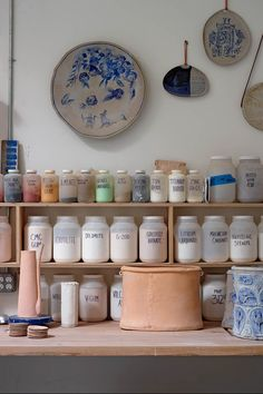 Tyle Hays .Crocks, mugs, plates and vases at various stages of completion in the ceramics studio.