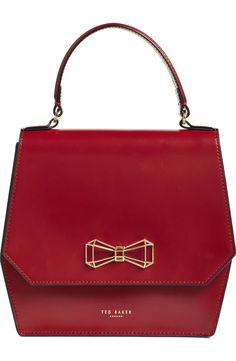 Ted Baker's signature bow is updated in a cool geometric style that echoes the angular silhouette of this understated crossbody bag with contemporary edge.