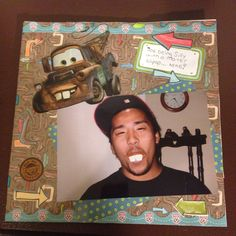 Silly Mater Pic, Joe with Mater teeth lollipop: This is a 8 by 8 scrapbook page with a large Mater sticker and road trip themed paper, border & stickers