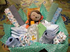 Copy cat Pinterest gift basket for baby shower. Circo, up and up brand, Burt's Bees wipes, Huggies diapers, and Fisher Price plush toy. I love Target! Used a basket from home. Total $32! Went halfsies with family, so only $16.