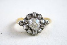 A stunning one-of-a-kind hand made antique diamond halo or cluster ring in 18k gold dating from c. 1830.