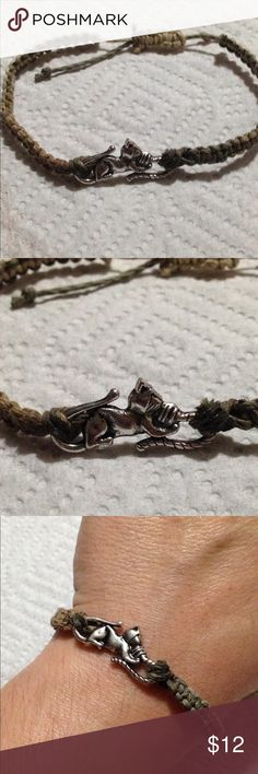 """‼SALE‼ Ombré Hemp Kitty Cat Bracelet This unique bracelet is made with natural hemp and a silver tone cat. This piece is adjustable and will fit a 7"""" wrist up to a 9"""" wrist. All PeaceFrog jewelry items are handmade by me! PeaceFrog Jewelry Bracelets"""