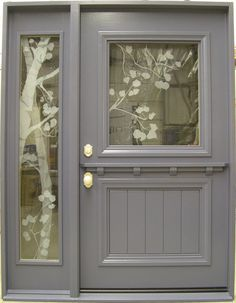 Modern dutch door. Etched glass window on door and sidelight. front door. dutch door. grey. gray. etched glass. sidelight. sideline.
