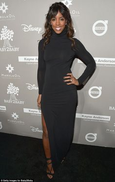 Classicly covered: Kelly Rowland, 34, stayed warm in a black, long sleeve turtleneck dress...
